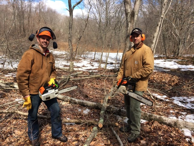 Aspetuck Land Trust is getting ready to clear a seven-acre space in its Trout Brook Valley Conservation Area in Weston and Easton. Pictured, from left, are ALT executive director David Brant and preserve manager Lou Bacchiocchi.