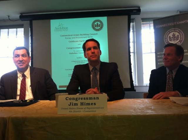 U.S. Rep. Jim Himes, speaks at an Earth Day event in Greenwich. At left is Bryan Garcia, CEO of the Clean Energy Finance and Investment Authority. At right is Stewart Hudson of Audubon Connecticut.
