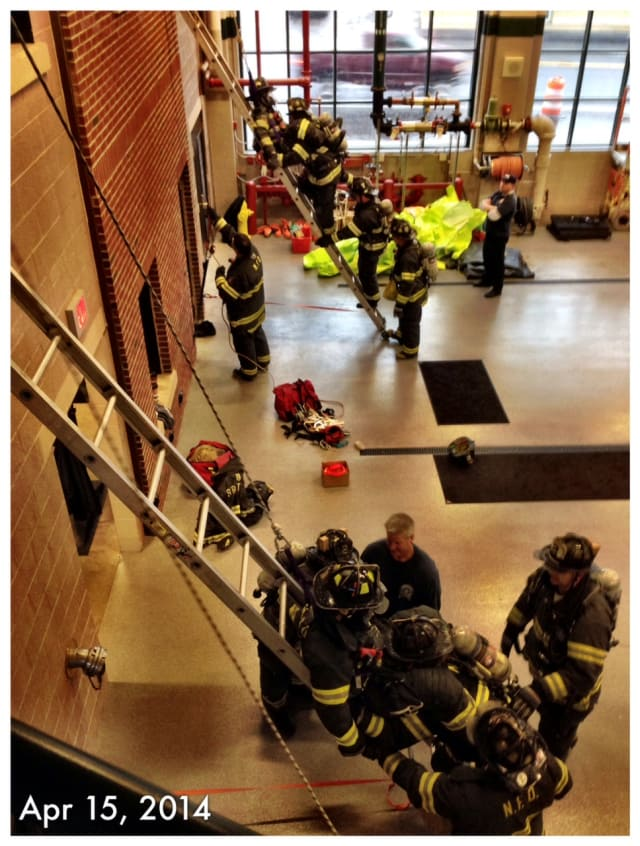 Norwalk firefighters take part in a simulated rescue inside the new fire headquarters on Connecticut Avenue.