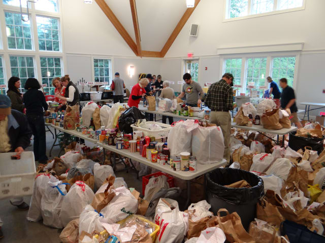 Food donations are ready for sorting at Person 2 Person in Darien.