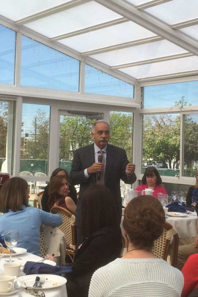 Norwalk's Schools Superintendent Manuel Rivera speaks at a meeting of the Mid Fairfield County Association of Realtors.