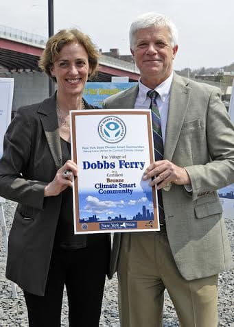 Dobbs Ferry's Nina Orville receives a New York state Climate Smart Climate Award from Joe Martens, state commissioner of environmental conservation.