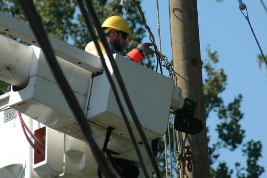 A CL&P lineman reconnects a power line in Norwalk after Hurricane Irene.