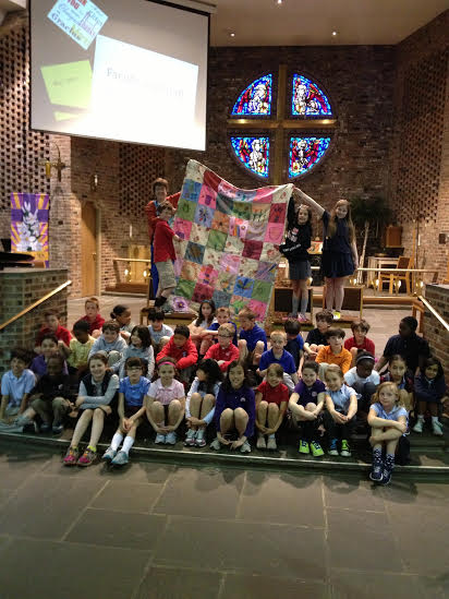 The Chapel School third graders proudly display their quilt.