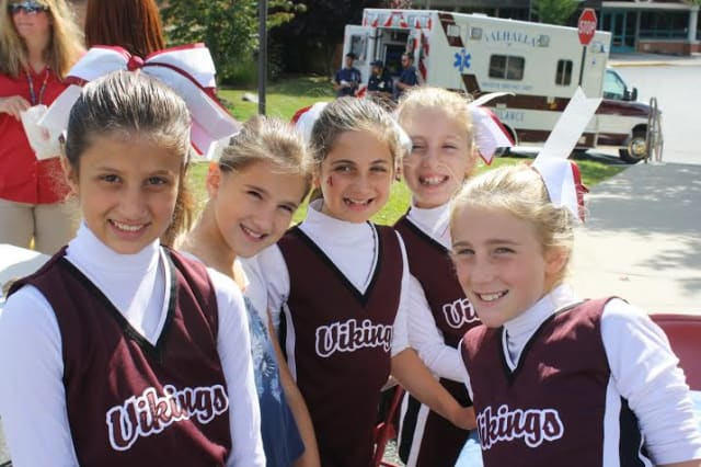 Valhalla school students like these girls will be dressed in red, white and blue on Thursday, May 21.
