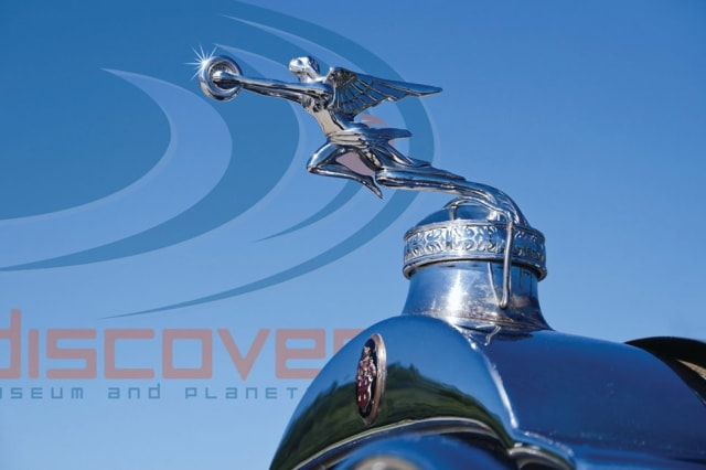 "The hood ornament of a classic Packard automobile salutes Discovery Museum's gala fundraiser ""The Science of Luxury: From Stars to Cars"" will be held on May 17 at Dragone Classic Motorcars in Westport,."