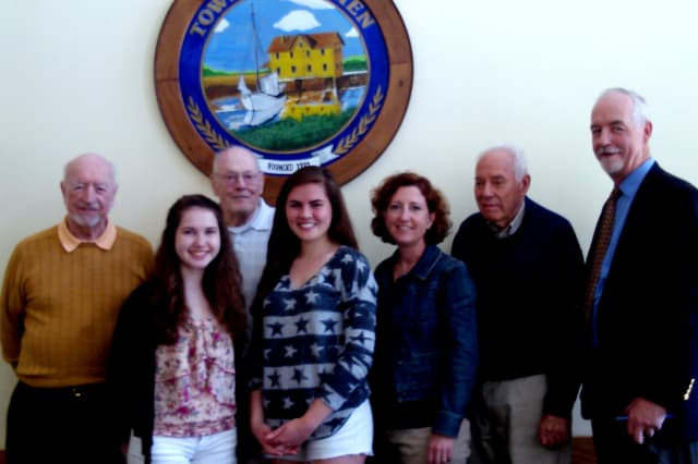 Monuments and Ceremonies Commission members of Darien honored Memorail Day essay contest winners. Left to right are George Walsh, Kathleen McIlree, John Geoghegan, Katy Murphy, Sueann Schorr, Chick Scribner and Terry Gaffney.