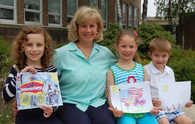 From left, Alexandra Martin, Susan Marks, Caroline Gies and Ian Schneeberger of Darien show off their winning artwork.