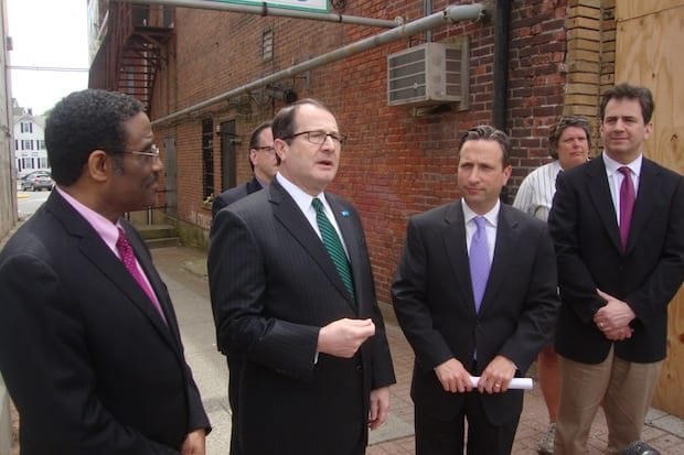 Representatives from Connecticut Light & Power, the state legislature and the Wall Street Theater announce new funding for the historic Norwalk theater's renovation.