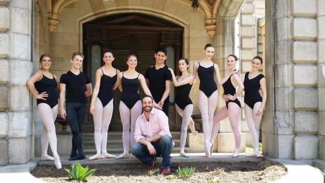 Norwalk Metropolitan Youth Ballet co-founder Adam Holms sits at the Lockwood-Matthews Mansion Museum in Norwalk among dancers.