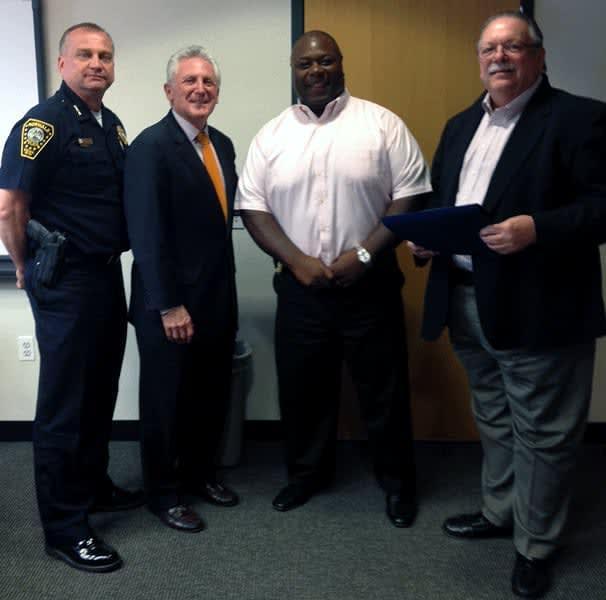 The Board of Police Commissioners honors Norwalk Detective Mark Edwards as Officer of the Month.