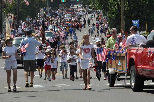 Norwalk's 2012 Memorial Day Parade makes its way toward the I-95 overpass at East Avenue.