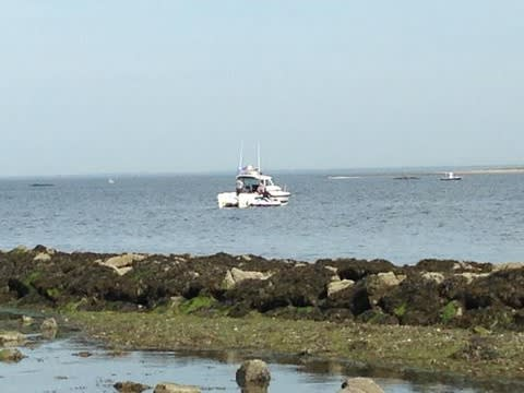 First responders search the waters of Long Island Sound off Norwalk for a missing boater on Monday.
