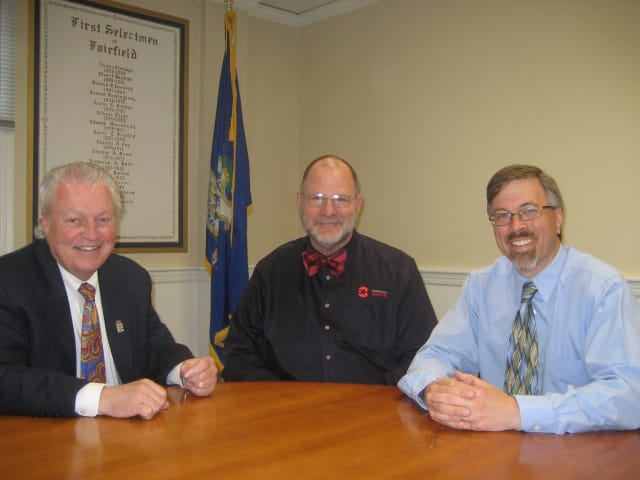 Fairfield First Selectman Mike Tetreau, Mario Bruno, American Red Cross Connecticut and Rhode Island Region CEO, and Community and Economic Development Director Mark Barnhart discuss a $150,000 grant for Superstorm Sandy relief efforts.