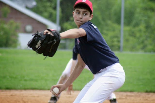 Christopher Cunningham pitches for the Norwalk Extreme 13-year-old team in a game last weekend. Norwalk went 3-1 to take the top spot in pool play of a tournament and advances to this weekend's championship round in New York.