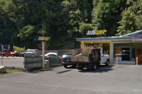 Police are searching for a suspect that robbed this Subway restaurant on Post Road East in Westport at gunpoint.