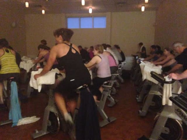 A 5:30 a.m. spin class of 40 members at Saw Mill Club has no problem with dedication.