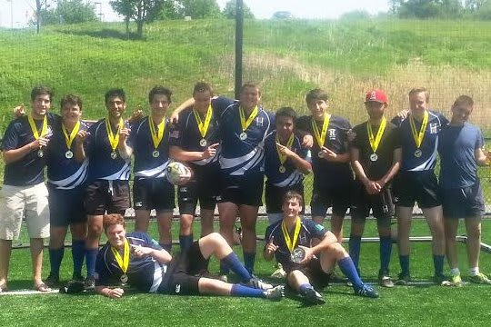 Seniors on Harvey's rugby team celebrate after winning the state title.