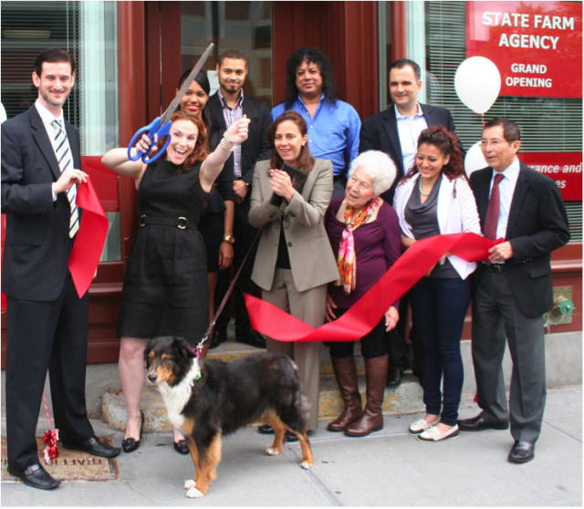Yonkers officials and State Farm employees celebrate the opening of the insurance company's new location -- and a donation to local animal shelters.