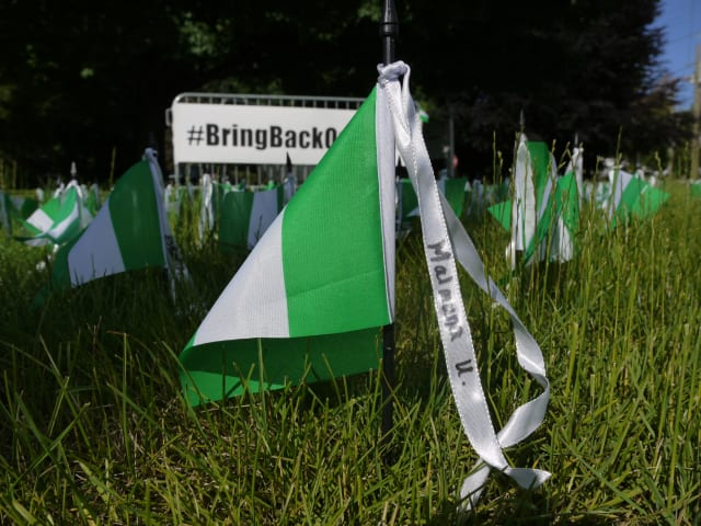 The Saugatuck Congregational Church in Westport hopes that its display of Nigerian flags with the names of the 300 missing girls will keep the topic on people's mind.