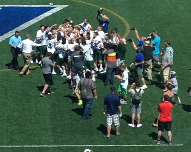 Yorktown players celebrate their seventh all-time state title.