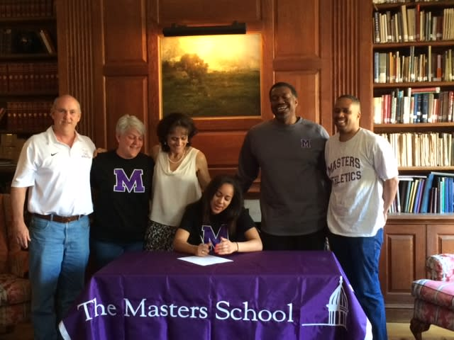 Masters School senior Naya Williams is joined by Athletic Director Kevin Versen, head coach Warren Bunkley and family as she signs her letter of intent.