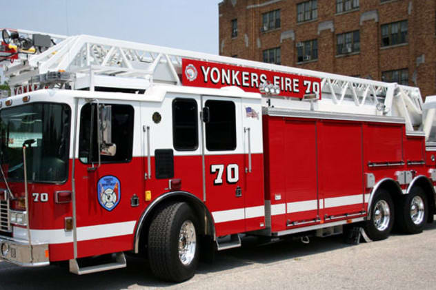 Two Yonkers firefighters were injured while battling a residential blaze on Wednesday morning.