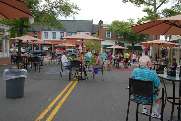 Diners enjoy the downtown Pop Up Park in New Canaan in a past year.