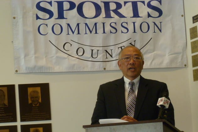 Wah Chu, the father of four-time Olympian Julie Chu, talks about his daughter's induction into the Fairfield County Sports Hall of Fame Tuesday in Stamford.