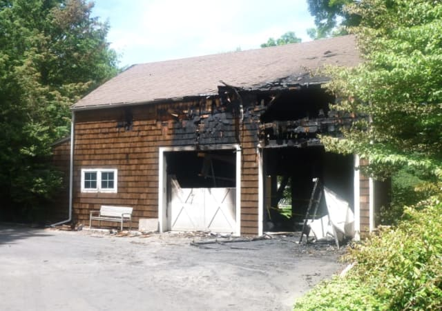 A two-car garage at 379 Hurlbutt St., was heavily damaged but he adjacent home was spared in the late night fire Thursday.