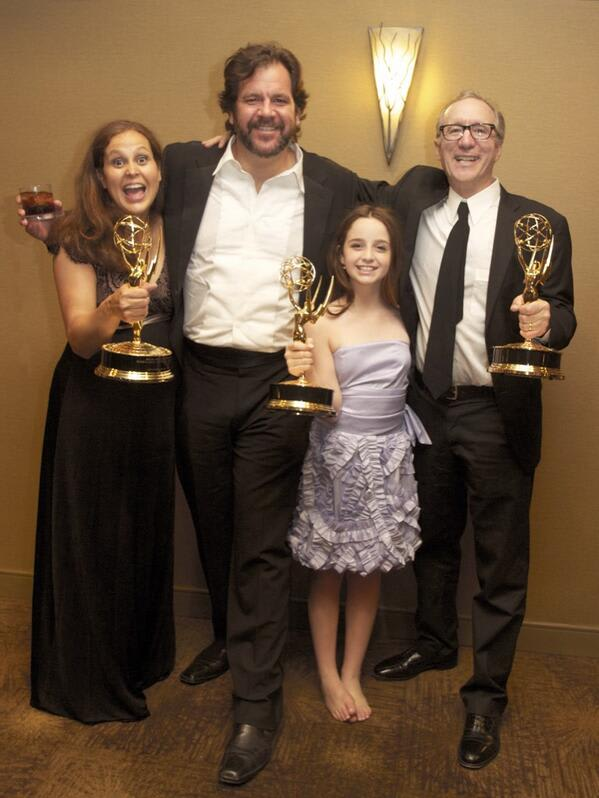 Hayley Negrin of Weston, second from right, poses with her Emmy and other winners from 'Peg + Cat.'