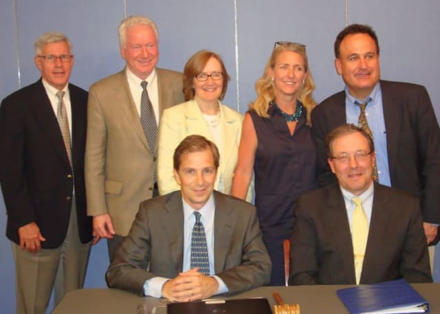 Bronxville Board President David Brashear and Trustee Pierre de Saint Phalle (sitting) with fellow Trustees Jeffrey Rohr, Jim Hudson, Denise Tormey, Ruth Wood and Chris Atayan.