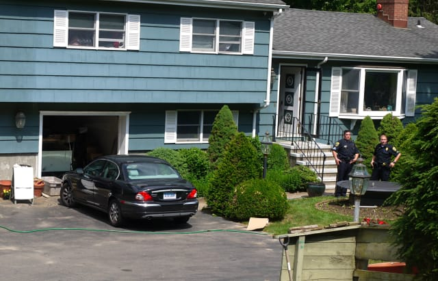 Fairfield Police officers are serving a search warrant at a house on Black Rock Turnpike after a woodchuck was shot on the property.