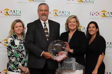 Brian Skanes, second from left with, Danae Richards, left, Ellen Lynch and Samantha Johns, president, Junior League of Northern Westchester,