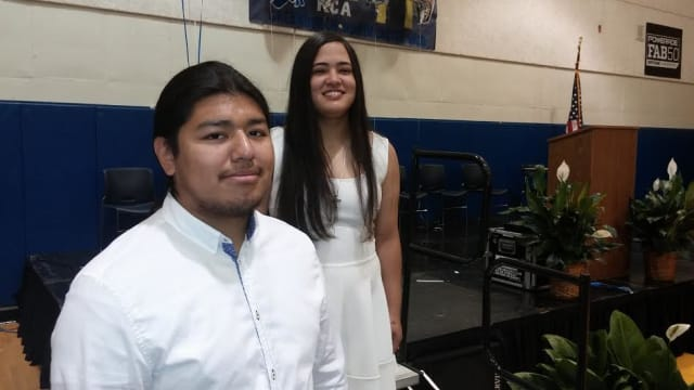 Clark Academy valedictorian Juergen Uraga, left, and salutatorian Mega Candelaria graduated Friday, June 27.