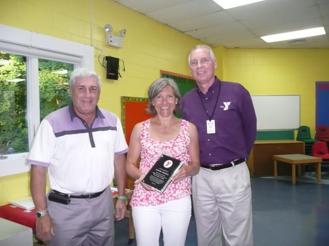 From left are Y Board President Howard Steinberg, Katherine Armstrong, and Y Executive Director Bob McDowell.