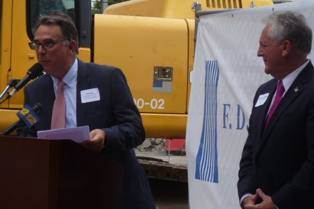 Thomas Rich, president and CEO of F.D. Rich Co., speaks at Monday's groundbreaking for SONO Pearl Apartments as Norwalk Mayor Harry Rilling stands by.