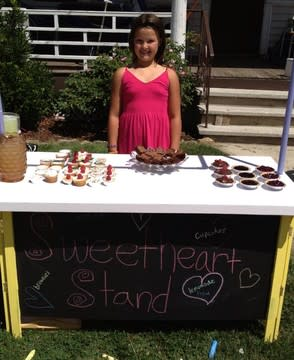 Emily Cartwright, seen here at her Sweetheart Stand, is raising funds to help children with cancer.