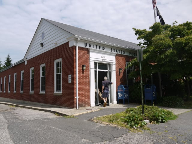 The distribution center at the Southport post office will remain open after residents cried out against a move to Bridgeport.