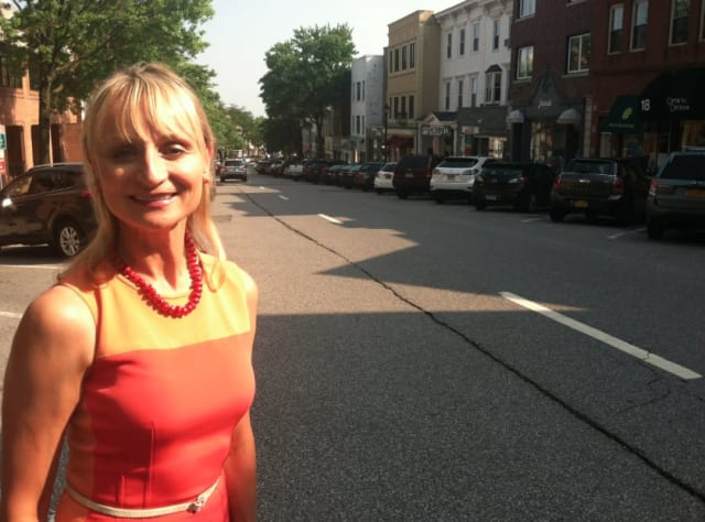 Greenwich Chamber of Commerce Executive Director Marcia O'Kane stands at the top of a quiet Greenwich Avenue on Tuesday afternoon. On Thursday, the Avenue will fill with shoppers as the four-day Sidewalk Sales begin.