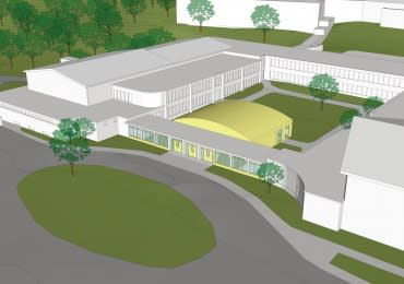 The proposed music / multi-purpose room at the middle school is represented by the yellow addition.