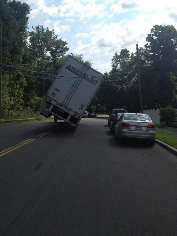 A truck is caught in power lines at Strawberry Hill Avenue by Norden Place in Norwalk on Friday morning.
