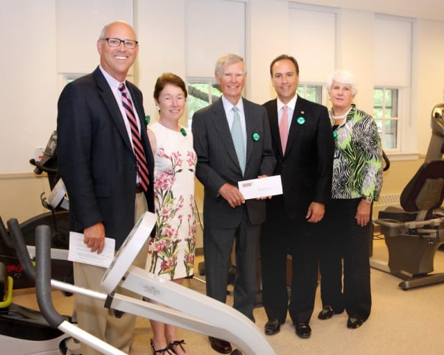 David Ormsby (center), chairman of the Friends of Nathaniel Witherell, presents a check to Greenwich First Selectman Peter J. Tesei (second from right). Also in photo are (from left) Allen Brown, Debby Lash and Karen Sadik-Khan.