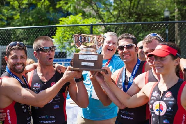 Triathletes from Chelsea Piers Connecticut in Stamford celebrate after a recent race.