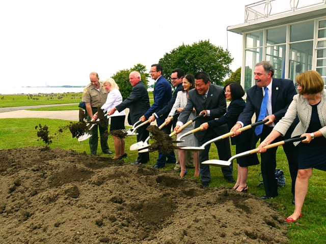 Local lawmakers join Gov. Dannel Malloy and DEEP Commissioner Rob Klee start the digging process at the Sherwood Island State Park Pavilion in Westport.