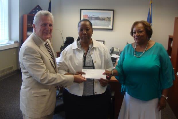 Mayor Harry Rilling, Novelette Peterkin of the Carver Foundation of Norwalk and Juanita James of the Fairfield County Community Foundation.