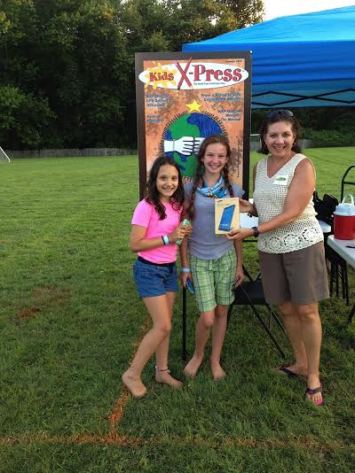 From left, Anya Glenn, Phoebe Katz and Nivia Viera, founder & publisher of Kids X-Press,