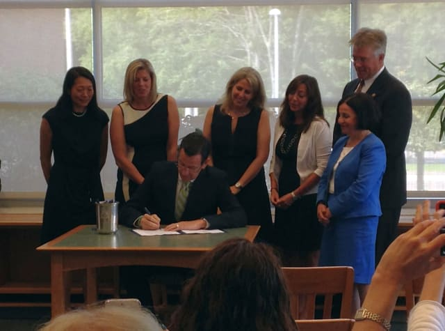 Gov. Dannel P. Malloy signs a new bill that allows school employees statewide to administer epinephrine to students experiencing a serious first-time allergic reaction.