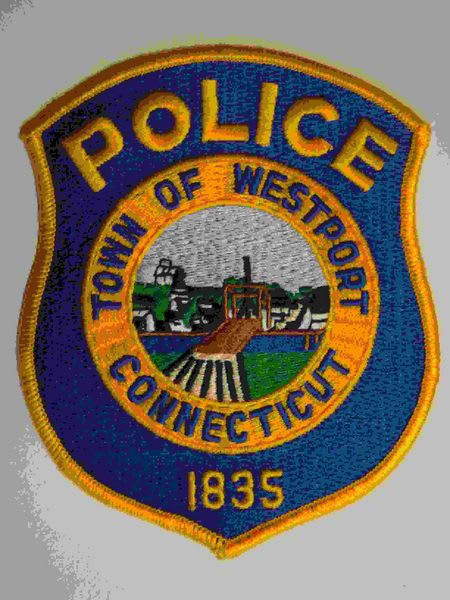 Westport Police arrested a man for allegedly fighting with a man and police officers on Sunday.