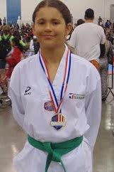 Emily Fields, 11, of Wilton won a gold medal recently at the Taekwondo National Championships in San Jose, Calif.